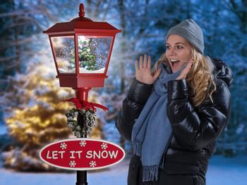 Snøende gatelykt med LED-belysning